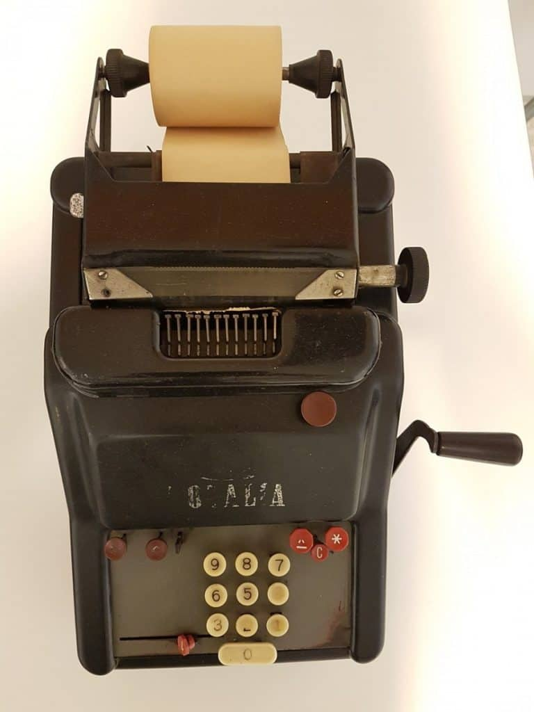out-dated equipment,,showing out adding machine
