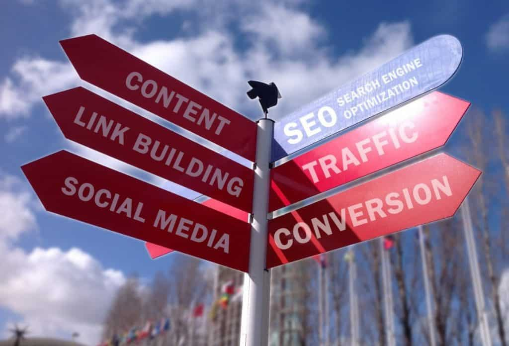 a street sign with seo- search engine optimization, content, link building, social media,traffic and conversion printed on it.