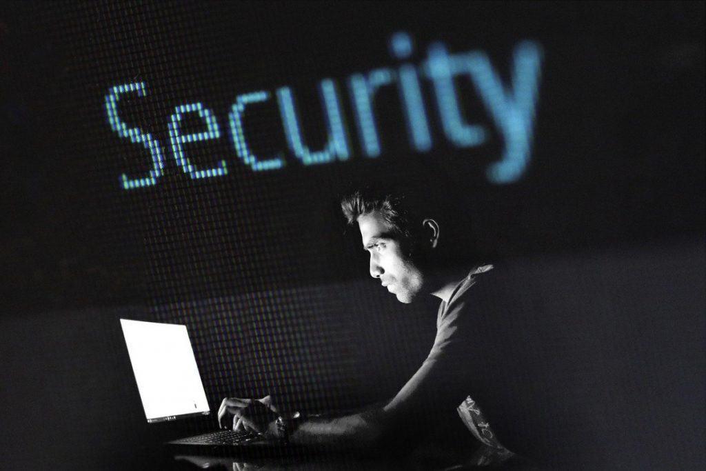 man working in the dark, on a dark website. presenting cybercrime