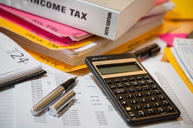 income tax time, calculator, tax books and sheets showing in photo