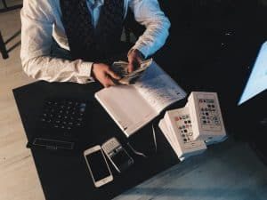 man counting money-ACH account