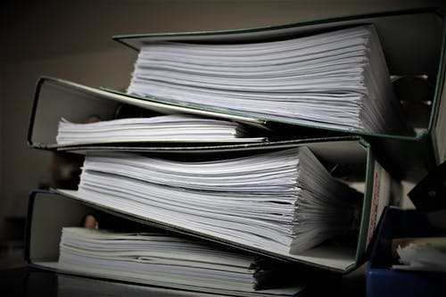 stack of large note books,representing files