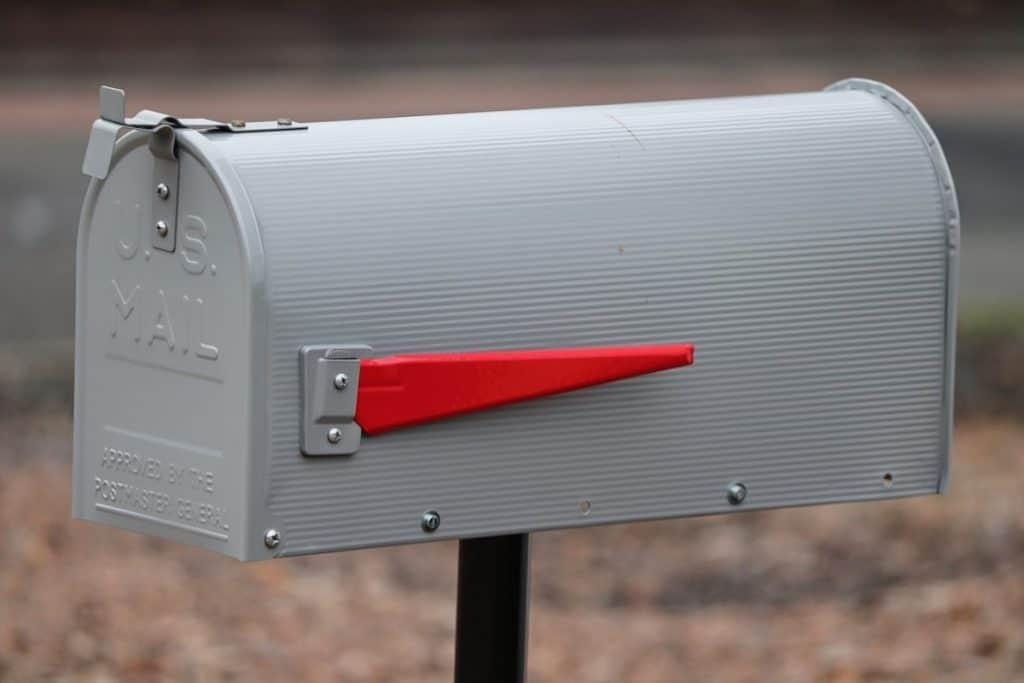 a mail box with a red flag. representing snail mail.