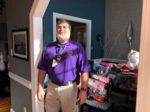 Sgt. Dan at PY house dropping off gifts.
